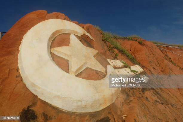 Original sign sculpted in the cliff in famous tourist beach resort which symbol is the moon and star in May 2013 in Canoa Quebrada Brazil