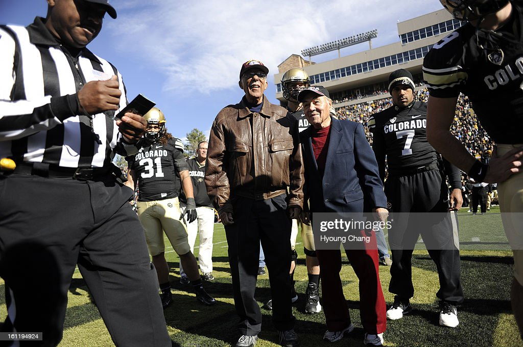 Original Tuskegee Airmen Colorado residents Captain Samuel C. Hunter, Jr., center left, and LtCol Marion Raymond Rodgers toss the coin for CU vs. Arizona game at Folsom Field in Boulder, Colorado, Saturday, November 12, 2011. CU won 48-29. Hyoung Chang, T : News Photo