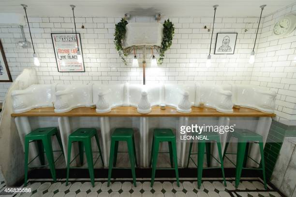 Original urinals and cisterns are pictured in Attendant a former public toilet that has been converted into a coffee shop and sandwich bar in central...