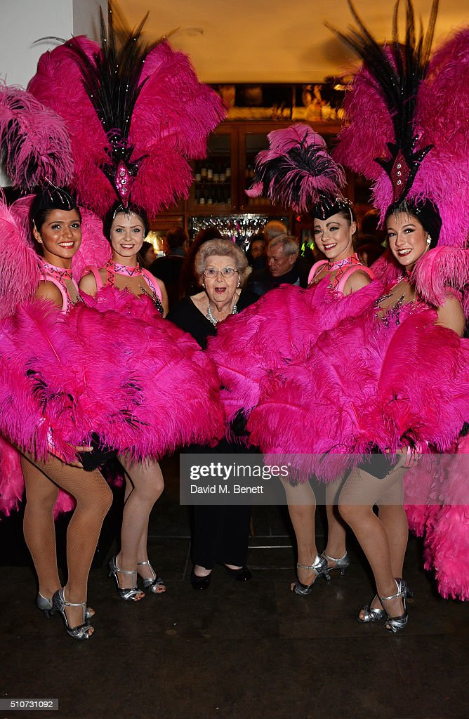 Original Windmill Girl Margaret McGrath (C) poses with dancers at the press night after party for 'Mrs Henderson Presents' at The National Cafe on February 16, 2016 in London, England.