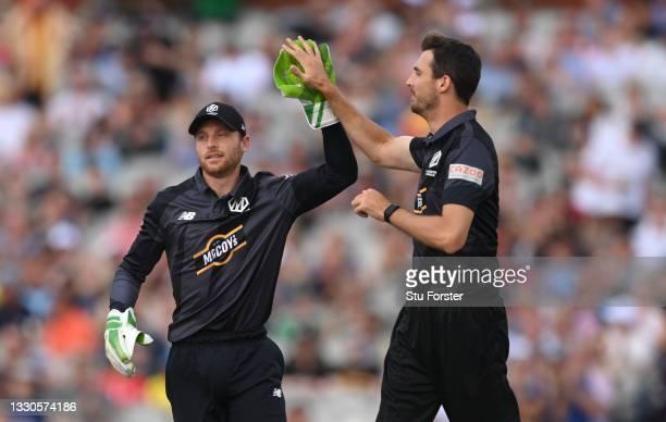Originals bowler Steven Finn celebrates a wicket with Jos Buttler during the Hundred match between Manchester Originals and Birmingham Phoenix at...