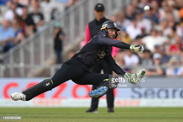 Originals wicketkeeper Jos Buttler throws at the stumps during the Hundred match between Manchester Originals and Birmingham Phoenix at Emirates Old...