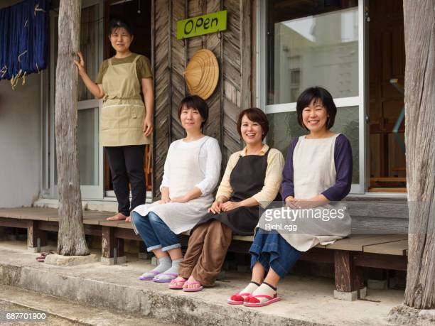 orimono textile shop in okinawa japan - okinawa prefecture stock pictures, royalty-free photos & images