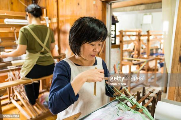 orimono textile shop - tdub_video stock pictures, royalty-free photos & images
