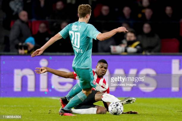 Oriol Busquets of FC Twente Denzel Dumfries of PSV during the Dutch Eredivisie match between PSV v Fc Twente at the Philips Stadium on January 26...