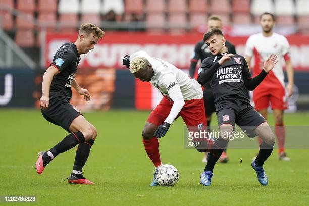 Oriol Busquets of FC Twente JeanChristophe Bahebeck of FC Utrecht Lindon Selahi of FC Twente during the Dutch Eredivisie match between FC Utrecht and...