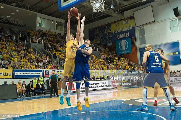 Oriol Pauli #21 of Herbalife Gran Canaria Las Palmas competes with Maxim Sheleketo #45 of Khimki Moscow Region during the Eurocup Basketball Final...