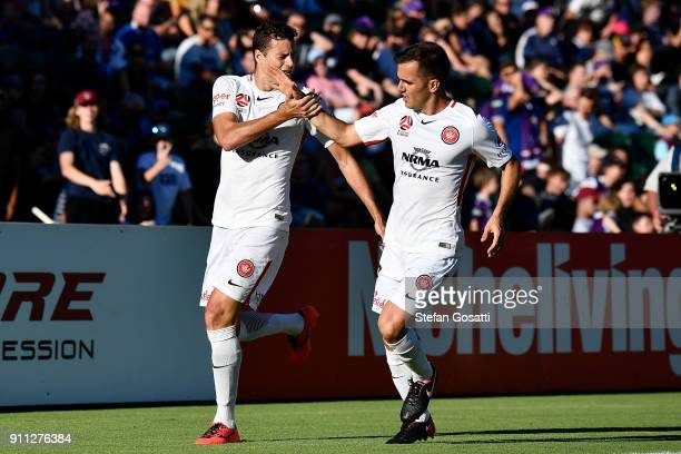 Oriol Riera is congratulated by Steven Lustica of the Wanderers after scoring during the round 18 ALeague match between the Perth Glory and the...