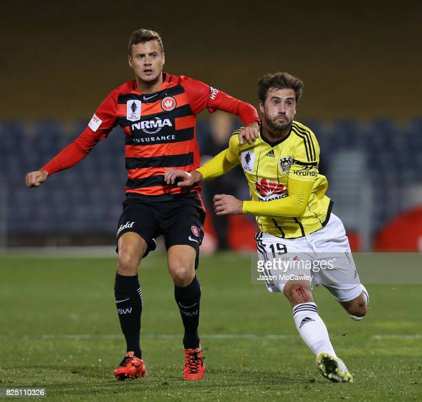 Oriol Riera of the Wanderers and Tom Doyle of the Phoenix compete for the ball during the FFA Cup round of 32 match between the Western Sydney...