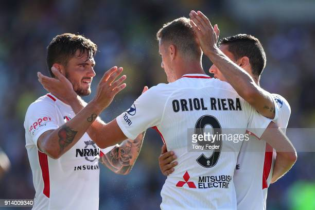 Oriol Riera of the Wanderers celebrates a goal with team mates during the round 19 A-League match between the Central Coast Mariners and the Western...