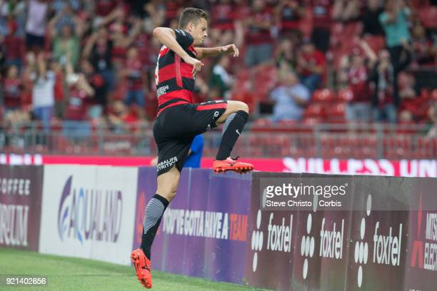 Oriol Riera of the Wanderers celebrates kicking a goal by leaping the signage during the round one ALeague match between the Western Sydney Wanderers...