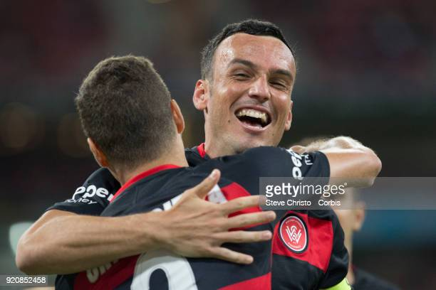 Oriol Riera of the Wanderers celebrates kicking a goal with captain Mark Bridge during the round one ALeague match between the Western Sydney...