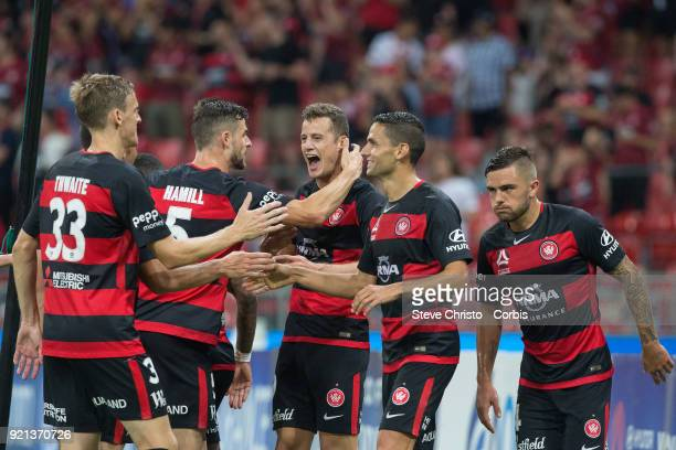 Oriol Riera of the Wanderers celebrates kicking a goal with his teammates during the round one ALeague match between the Western Sydney Wanderers and...