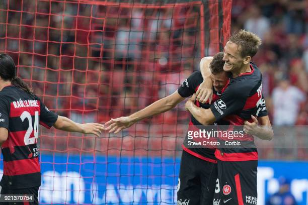 Oriol Riera of the Wanderers celebrates kicking a goal with Michael Thwaite during the round one ALeague match between the Western Sydney Wanderers...