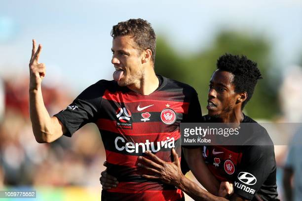 Oriol Riera of the Wanderers celebrates with Bruce Kamau of the Wanderers after scoring a goal during the round four ALeague match between the...