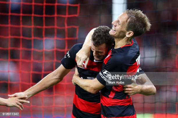 Oriol Riera of the Wanderers celebrates with his team mate Michael Thwaite of the Wanderers after scoring a goal during the round 20 ALeague match...