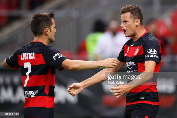 Oriol Riera of the Wanderers celebrates with his team mate Steven Lustica of the Wanderers after scoring a goal during the round 20 ALeague match...