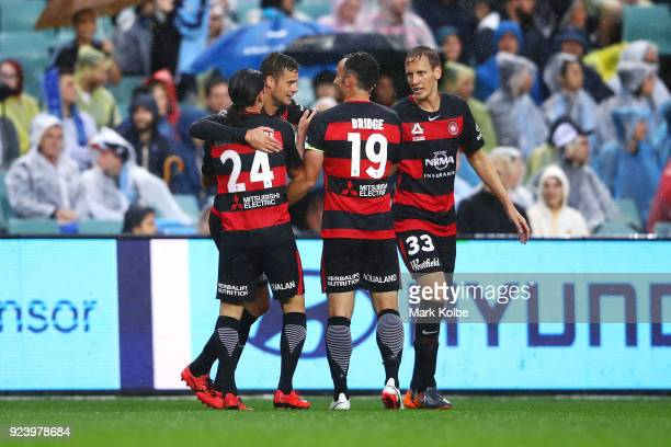 Oriol Riera of the Wanderers celebrates with his team mates after scoring a goal during the round 21 ALeague match between Sydney FC and the Western...