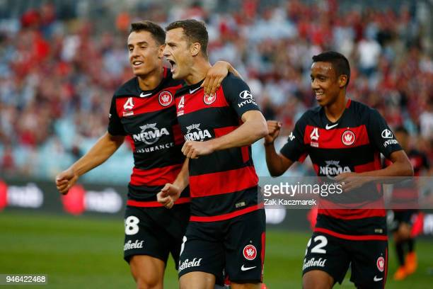 Oriol Riera of the Wanderers celebrates with team mates after scoring a goal from the penalty spot during the round 27 ALeague match between the...