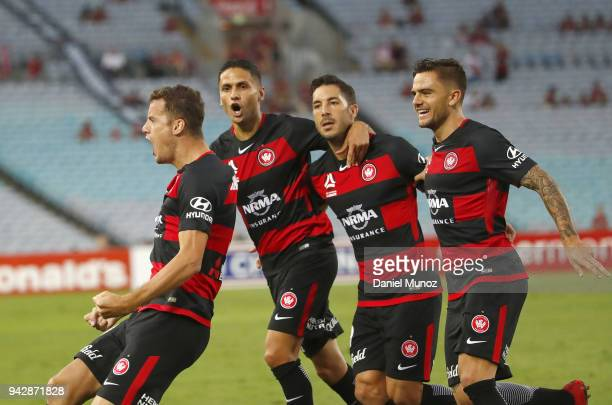 Oriol Riera of the Wanderers celebrates with teammates after scoring during the round 26 ALeague match between the Western Sydney Wanderers and the...