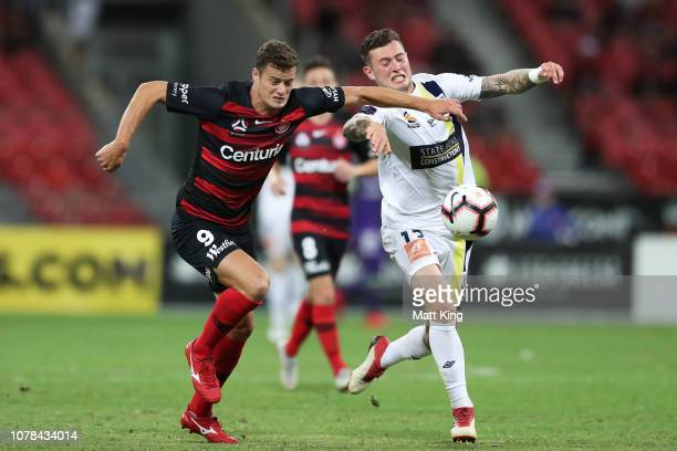 Oriol Riera of the Wanderers competes for the ball against Aiden O'Neill of the Mariners during the round seven ALeague match between the Western...