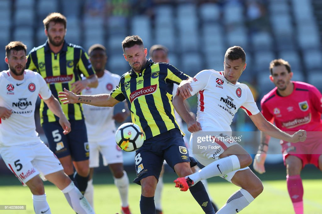 Oriol Riera of the Wanderers contests the ball with Blake Powell of the Mariners during the round 19 A-League match between the Central Coast Mariners and the Western Sydney Wanderers at Central Coast Stadium on February 4, 2018 in Gosford, Australia.