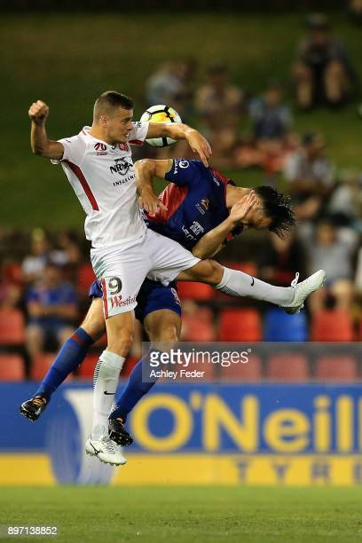 Oriol Riera of the Wanderers contests the header against Nigel Boogaard of the Jets during the round 12 ALeague match between the Newcastle Jets and...