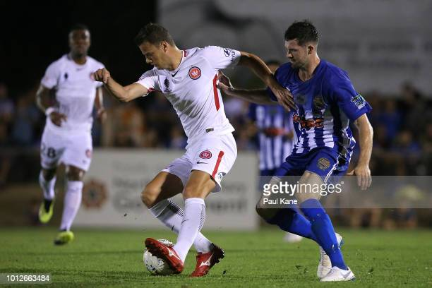 Oriol Riera of the Wanderers controls the ball against Matthew Cawley of Hellenic during the FFA Cup round of 32 match between Hellenic AC and...