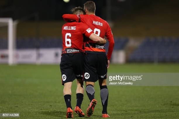 Oriol Riera of the Wanderers embraces Jacob Melling during the FFA Cup round of 32 match between the Western Sydney Wanderers and the Wellington...