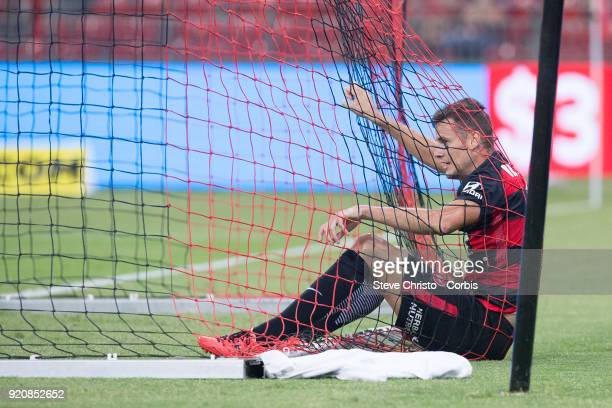 Oriol Riera of the Wanderers ends up in the back of the net after missing a scoring opportunity during the round one ALeague match between the...