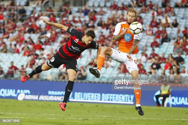 Oriol Riera of the Wanderers heads the ball to score a goal under the pressure of Jacob Pepper of the Roar during the round 26 ALeague match between...