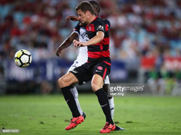 Oriol Riera of the Wanderers is challenged by Jason Geria of the Victory during the round 17 ALeague match between the Western Sydney Wanderers and...