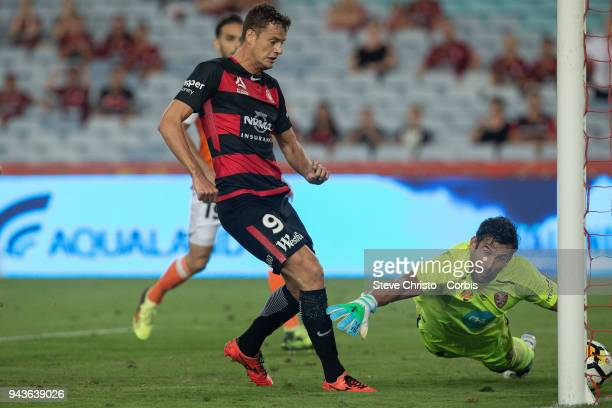Oriol Riera of the Wanderers kicks the ball past a diving Jamie Young and scores a goal during the round 26 ALeague match between the Western Sydney...