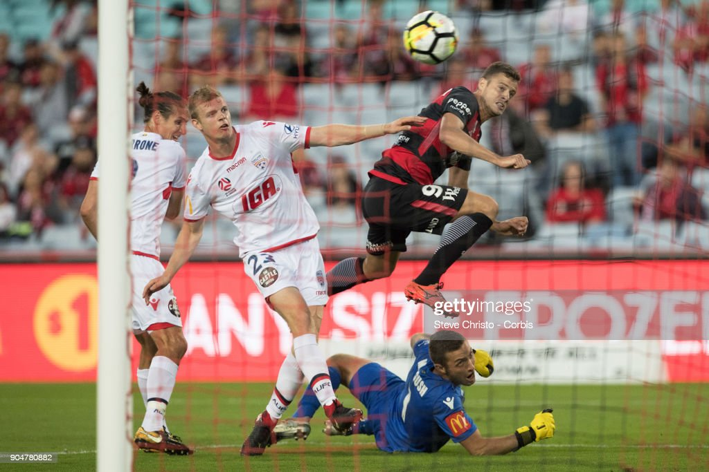 Oriol Riera of the Wanderers shoots for goal and leaps over United's goalkeeper Daniel Margush during the round fifteen of the A-League match between Western Sydney Wanderers and Adelaide United at Stadium Australia on January 10, 2018 in Sydney, Australia.