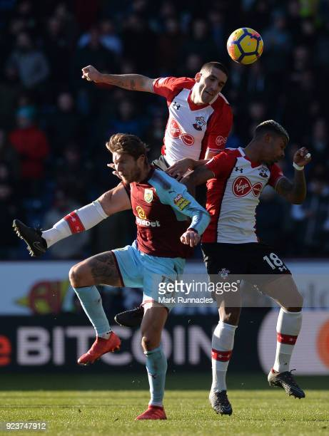 Oriol Romeu and Mario Lemina of Southampton battle for the header with Jeff Hendrick of Burnley during the Premier League match between Burnley and...