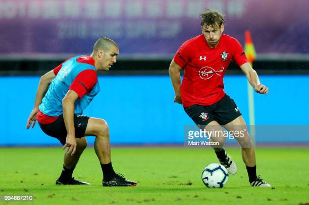 Oriol Romeu and Stuart Armstrong during a Southampton FC training session while on their pre season tour of China on July 9 2018 in Xuzhou China
