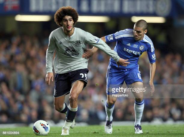 Oriol Romeu of Chelsea and Marouane Fellaini of Everton in action during a Barclays Premier League match at Stamford Bridge on October 15 2011 in...