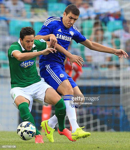 Oriol Romeu of Chelsea competes for the ball against Andraz Sporar of FC Olimpija Ljubljana during the Pre Season Friendly match between FC Olimpija...