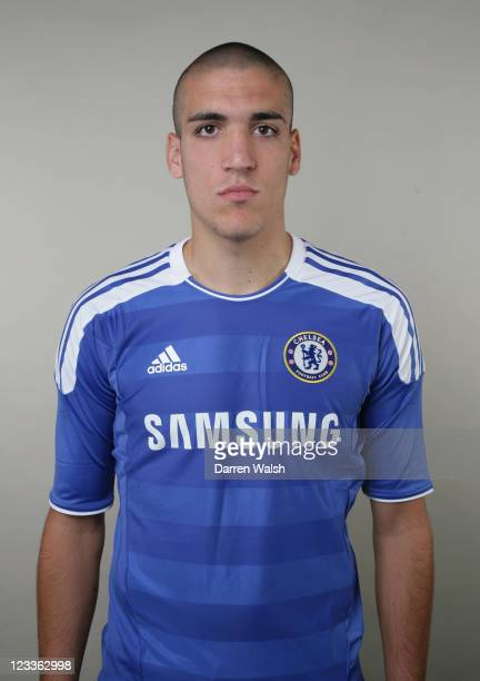 Oriol Romeu of Chelsea poses during the Chelsea FC Photocall at the Cobham training ground on August 26 2011 in Cobham England