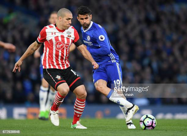 Oriol Romeu of Southampton and Diego Costa of Chelsea battle for the ball during the Premier League match between Chelsea and Southampton at Stamford...