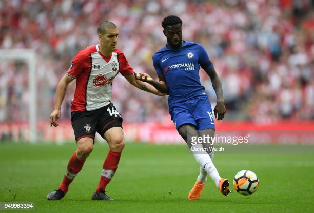 Oriol Romeu of Southampton and Tiemoue Bakayoko of Chelsea battle for the ball during The Emirates FA Cup Semi Final match between Chelsea and...