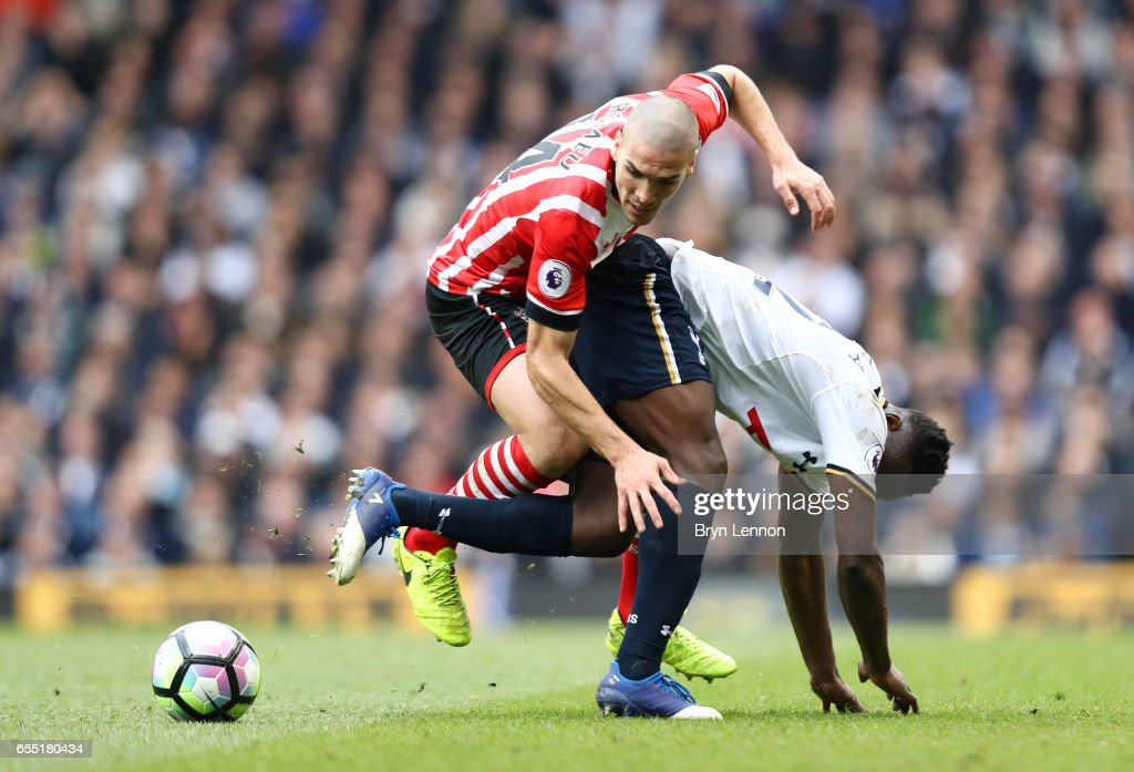 Oriol Romeu of Southampton (L) and Victor Wanyama of Tottenham Hotspur (R) battle for possession during the Premier League match between Tottenham Hotspur and Southampton at White Hart Lane on March 19, 2017 in London, England.