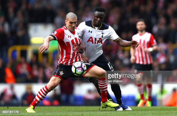 Oriol Romeu of Southampton and Victor Wanyama of Tottenham Hotspur battle for possession during the Premier League match between Tottenham Hotspur...