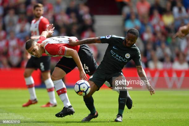 Oriol Romeu of Southampton battles for possession with Raheem Sterling of Manchester City during the Premier League match between Southampton and...