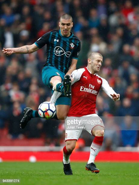 Oriol Romeu of Southampton battles with Jack Wilshire of Arsenal during the Premier League match between Arsenal and Southampton at Emirates Stadium...