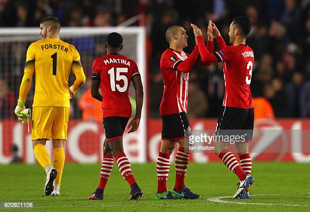 Oriol Romeu of Southampton celebrates with Maya Yoshida of Southampton after winning the UEFA Europa League Group K match between Southampton FC and...