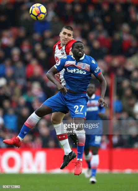 Oriol Romeu of Southampton competes for a header with Bojan Krkic of Stoke City during the Premier League match between Southampton and Stoke City at...