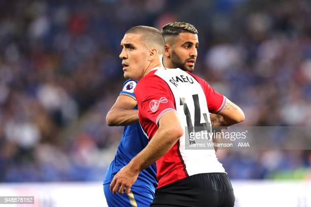 Oriol Romeu of Southampton holds back Riyad Mahrez of Leicester City during the Premier League match between Leicester City and Southampton at The...