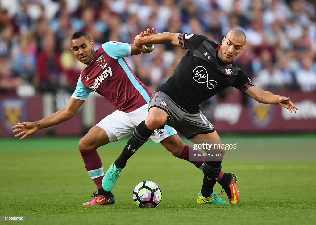 Oriol Romeu of Southampton holds off Dimitri Payet of West Ham United during the Premier League match between West Ham United and Southampton at London Stadium on September 25, 2016 in London, England.