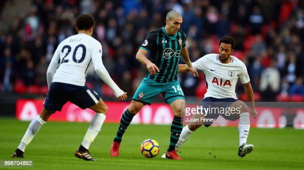 Oriol Romeu of Southampton is put under pressure by Mousa Dembele of Tottenham Hotspur during the Premier League match between Tottenham Hotspur and...